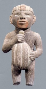 Aztec figure holding cacao pod