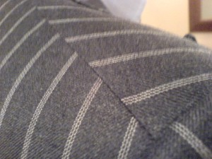 Unmatching stripes at the shoulder seam - classic Savile Row bespoke