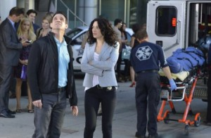 "WAREHOUSE 13 --  ""The Sky's The Limit"" Episode 414 -- Pictured: (l-r) Pete Lattimer as Eddie McClintock, Joanne Kelly as Myka Bering -- (Photo by: Steve Wilkie/Syfy)"