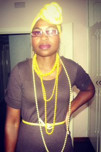 Eva Mutsago in her African home demonstrating colour-blocking