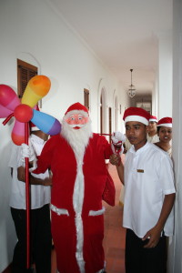 Hotel staff singing Xmas carols